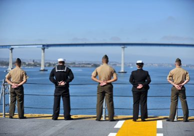Marines and sailors with the 11th Marine Expeditionary Unit, Amphibious Squadron 5 and USS Makin Island man the rails as the ship sails through the San Diego harbor beginning a seven-month deployment through the Western Pacific and Middle East regions here Nov. 14.